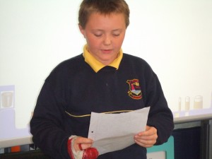 Lee reading his story to the class
